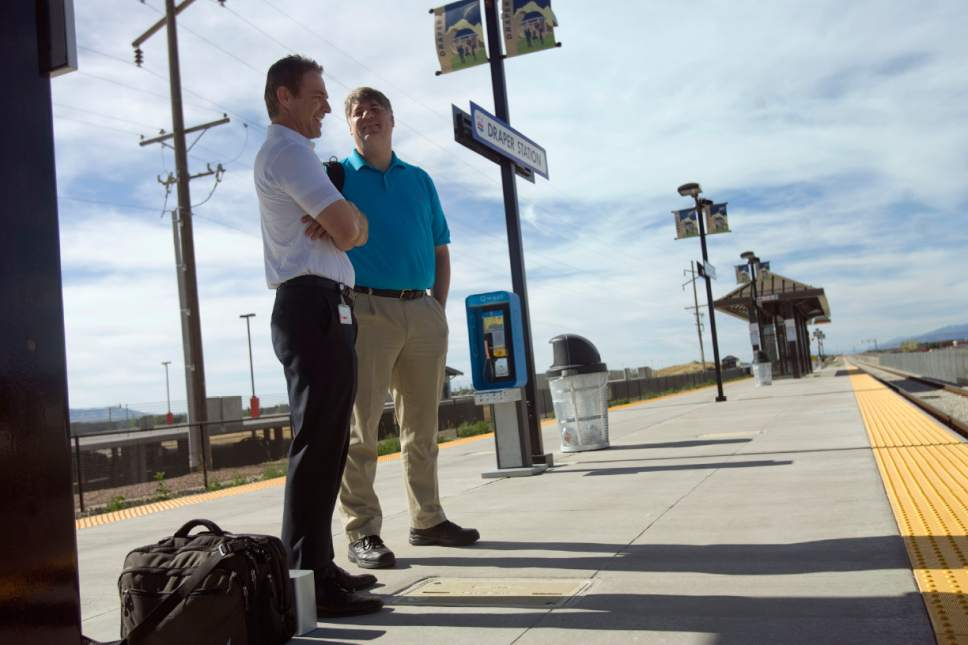 |  Tribune File Photo  (left) Troy Gundersen and (right) Sean Adair, who work nearby, wait to board a UTA FrontRunner train at the Draper Station on June 6, 2013.