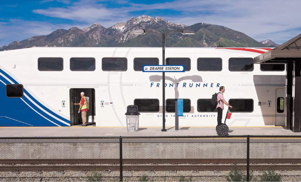 |  Tribune File Photo  People exit a southbound UTA FrontRunner train at the Draper Station on June 6, 2013.