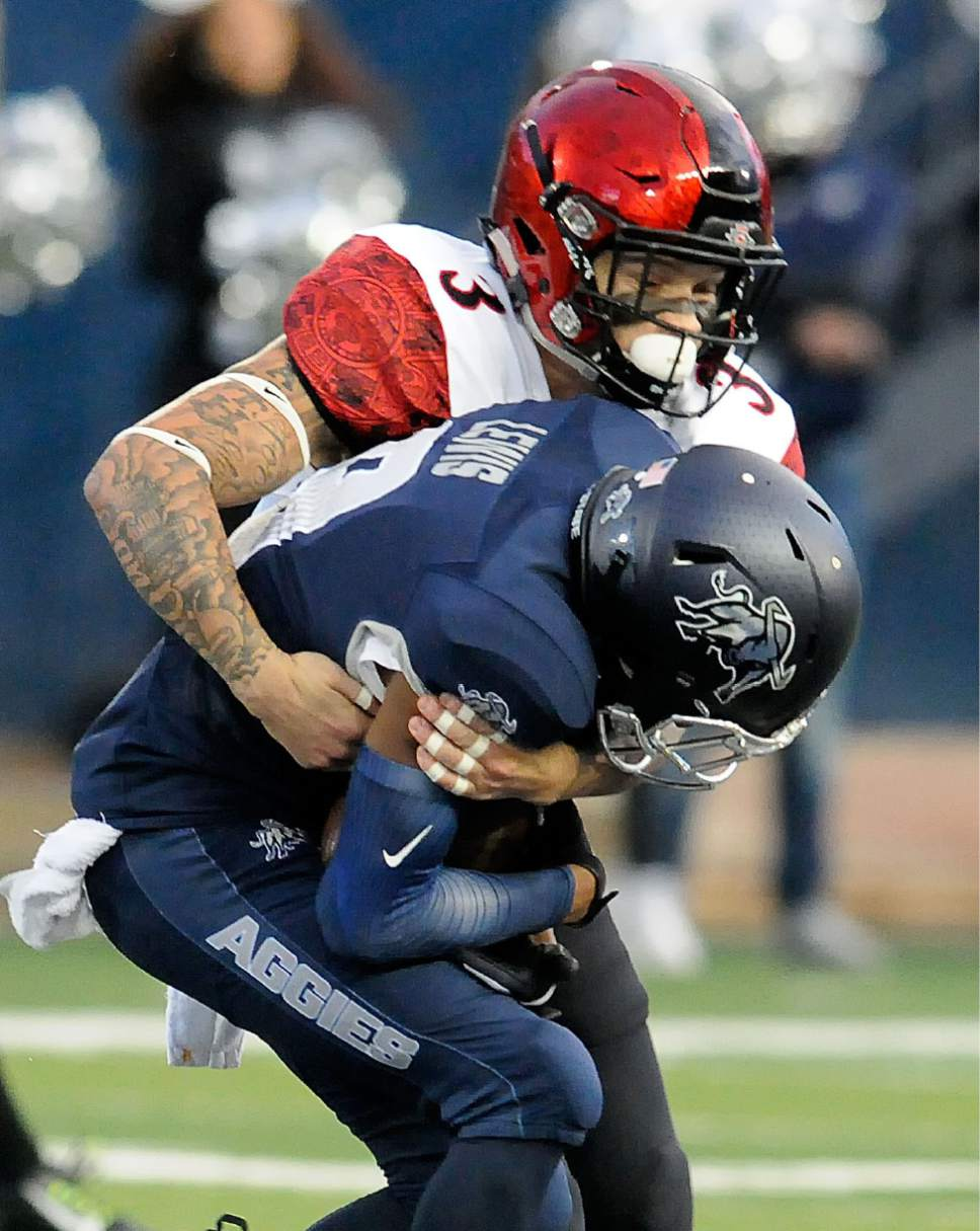 San Diego State safety Trey Lomax (3) tackles Utah State wide receiver Rayshad Lewis during an NCAA college football game Friday, Oct. 28, 2016, in Logan, Utah. (Eli Lucero/Herald Journal via AP)