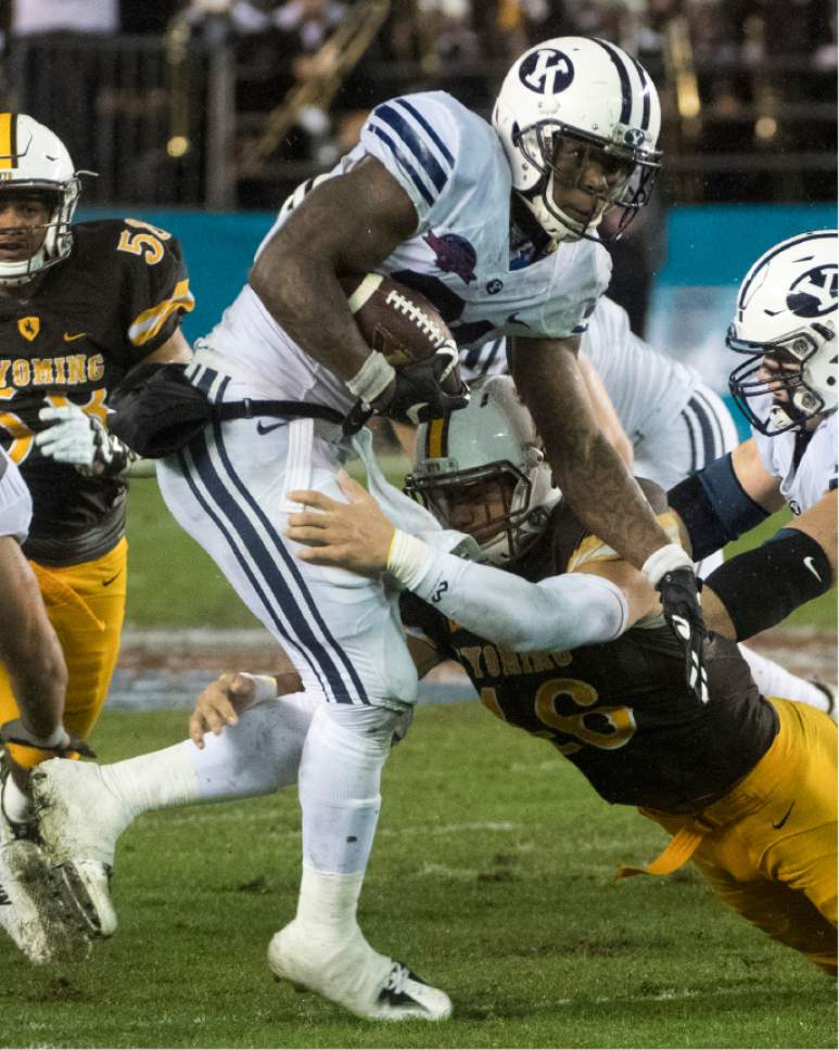 Rick Egan  |  The Salt Lake Tribune  Brigham Young Cougars running back Jamaal Williams (21) ran for 210 yards as BYU defeated the Wyoming Cowboys, 24-21, in the Poinsettia Bowl, at Qualcomm Stadium in San Diego, December 21, 2016.
