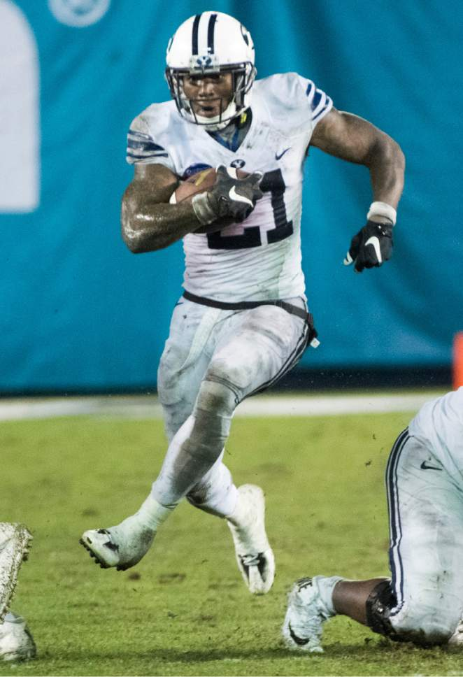 Rick Egan  |  The Salt Lake Tribune  Brigham Young Cougars running back Jamaal Williams (21) runs for a 36-yard touchdown for the Cougars, in football action, Brigham Young Cougars vs. Wyoming Cowboys in the Poinsettia Bowl, at Qualcomm Stadium in San Diego, December 21, 2016.