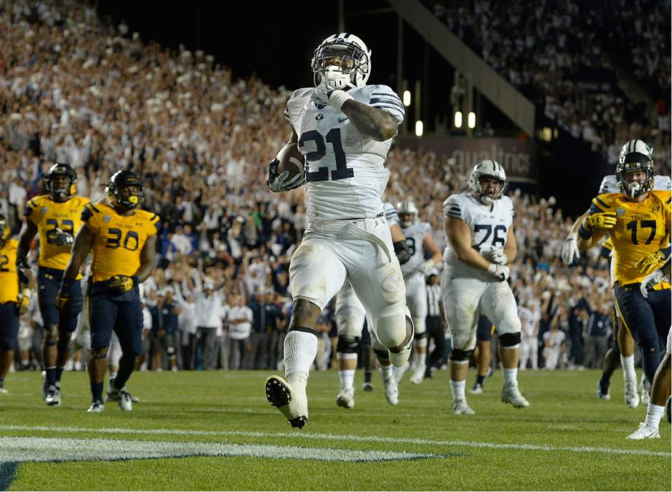 Scott Sommerdorf   |  The Salt Lake Tribune   BYU RB Jamaal Williams (21) scores his fifth TD on a 14 yard run to give BYU a 52-45 fourth quarter lead. BYU defeated Toledo 55-53, Friday, September 30, 2016.