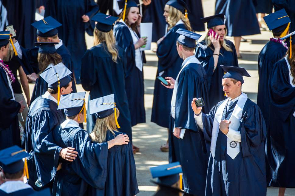 Chris Detrick  |  The Salt Lake Tribune BYU students mingle outside of the Marriott Center after the Commencement Services Thursday April 21, 2016.