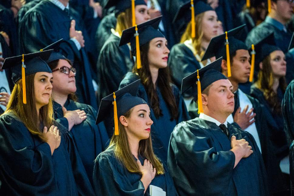 Chris Detrick  |  The Salt Lake Tribune BYU students listen during the Commencement Services at the Marriott Center Thursday April 21, 2016.