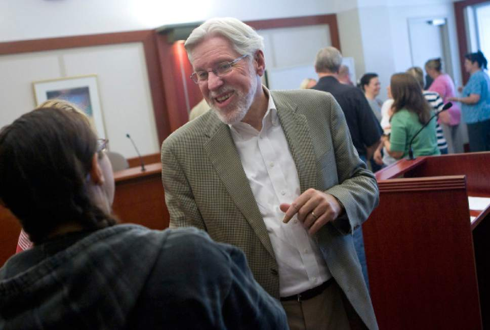 Al Hartmann      The Salt Lake Tribune  Judge Robert Hilder, right, says goodbye to friends and legal staff during a farewell party in his courtroom at the Matheson Courthouse Friday July 29, 2011. Hilder is retiring after 17 years on the bench.