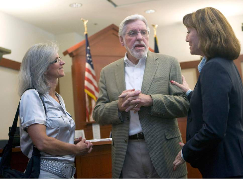 Al Hartmann      The Salt Lake Tribune   Judge Robert Hilder, center,  shares stories with mediator Karin Hobbs, left, and lawyer Sharon Donovan, right,  during a farewell party in his courtroom at the Matheson Courthouse Friday July 29, 2011. Both women worked in his courtroom over the years. Hilder is retiring after 17 years on the bench.