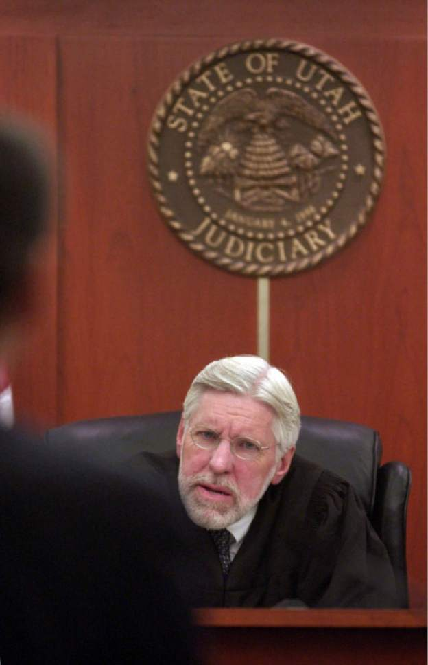 Francisco Kjolseth     The Salt Lake Tribune  Judge Robert K. Hilder questions a point made by Nancy Workman's defense attorney, Greg Skordas during a preliminary hearing on Monday October 4, 2004. Salt Lake County Mayor Nancy Workman faces her preliminary hearing on two felony charges of misuse of public money.