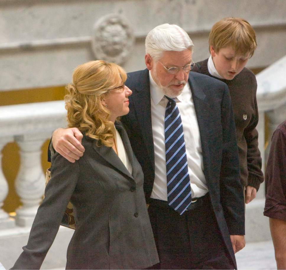   Tribune File Photo  Judge Robert Hilder, with his arm around his wife Jan, walks down the stairs from the senate chambers at the state capitol Wednesday, November 19, 2008, after the senate failed to confirm  his appointment to the Utah Court of Appeals. The Hilder's son Nat, (13) walks next to his father.