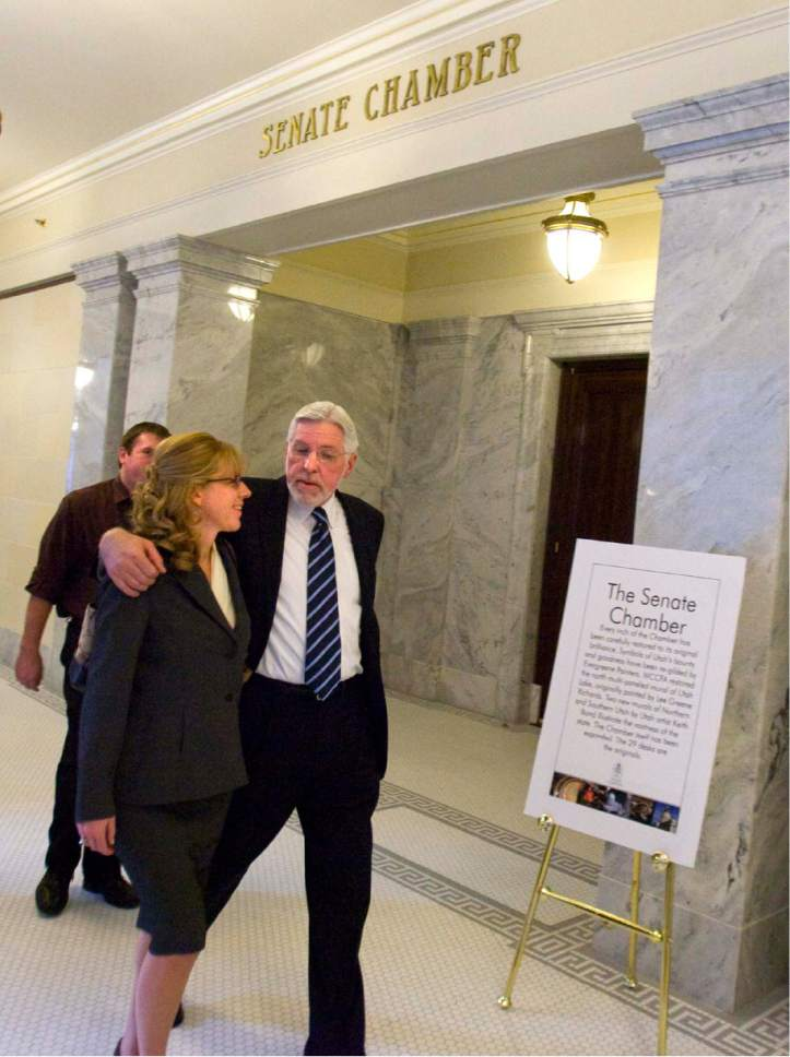    Tribune File Photo  Judge Robert Hilder, with his arm around his wife Jan, walks down the hallway leaving  he senate chambers at the state capitol on Wednesday, November 19, 2008. The senate failed to confirm  his appointment to the Utah Court of Appeals.