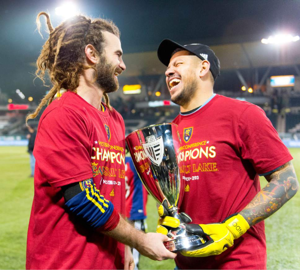 Trent Nelson  |  The Salt Lake Tribune Real Salt Lake's Kyle Beckerman (5) and Nick Rimando (18) hold the Western Conference trophy after defeating the Portland Timbers, MLS soccer Sunday November 24, 2013 in Portland.