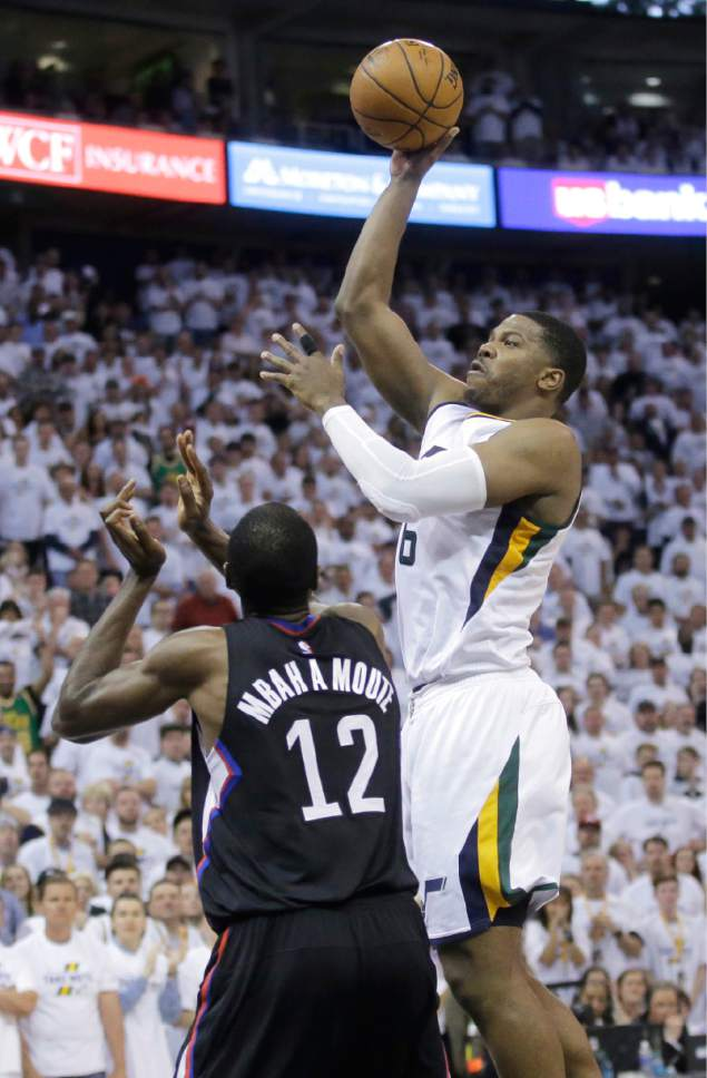 106eea23b02 Utah Jazz forward Joe Johnson (6) shoots as Los Angeles Clippers forward  Luc Mbah