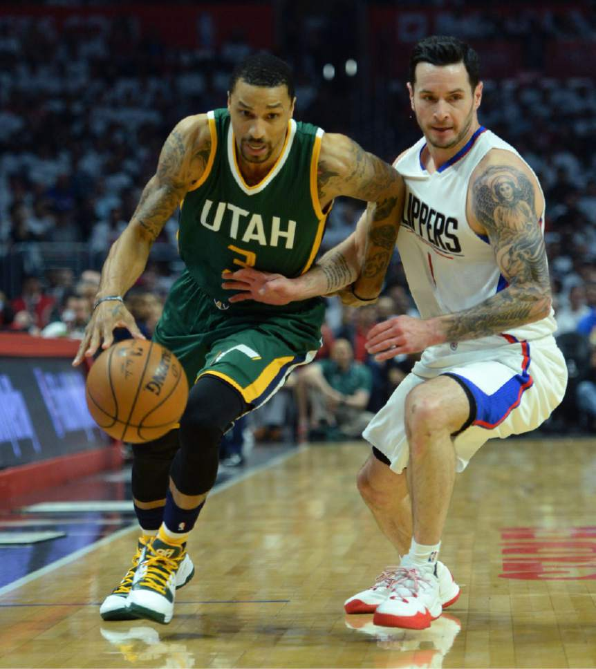 Steve Griffin  |  The Salt Lake Tribune   Utah Jazz guard George Hill (3) drives on LA Clippers guard JJ Redick (4) during game 5 of the the Jazz versus Clippers NBA playoff game at the Staples Center in Los Angeles Tuesday April 25, 2017.