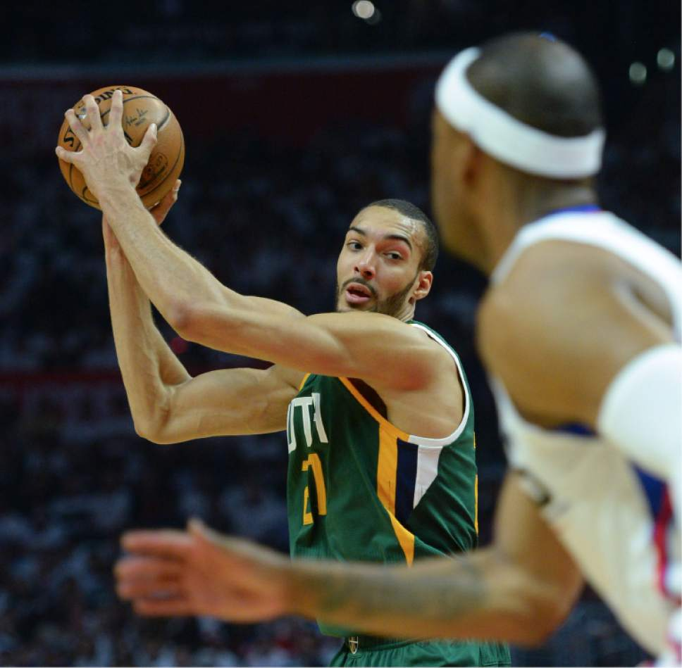 Steve Griffin  |  The Salt Lake Tribune   Utah Jazz center Rudy Gobert (27) keeps the ball high as he looks to pass during game 5 of the the Jazz versus Clippers NBA playoff game at the Staples Center in Los Angeles Tuesday April 25, 2017.