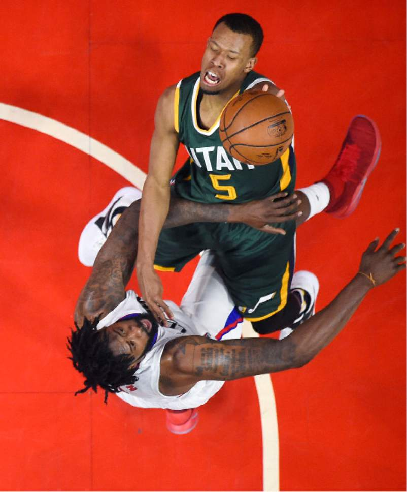 Utah Jazz guard Rodney Hood, top, shoots as Los Angeles Clippers center DeAndre Jordan defends during the first half in Game 5 of an NBA basketball first-round playoff series, Tuesday, April 25, 2017, in Los Angeles. (AP Photo/Mark J. Terrill)