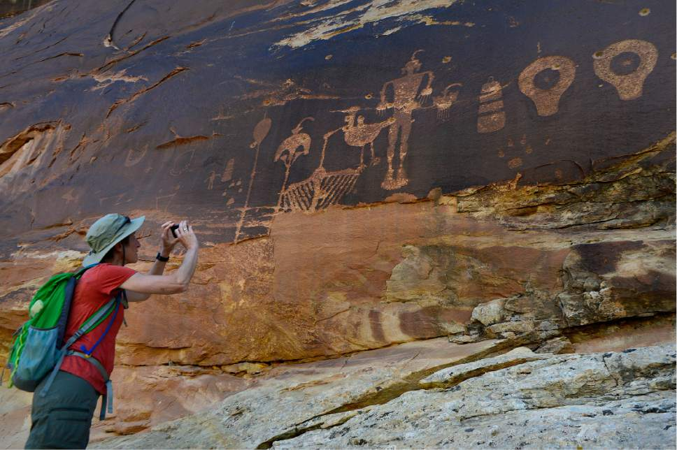 Scott Sommerdorf   |  The Salt Lake Tribune   U.S. Interior Secretary Sally Jewell takes a photo of  ancient petroglyphs near Comb Ridge, outside Bluff, Saturday, July 16, 2016.