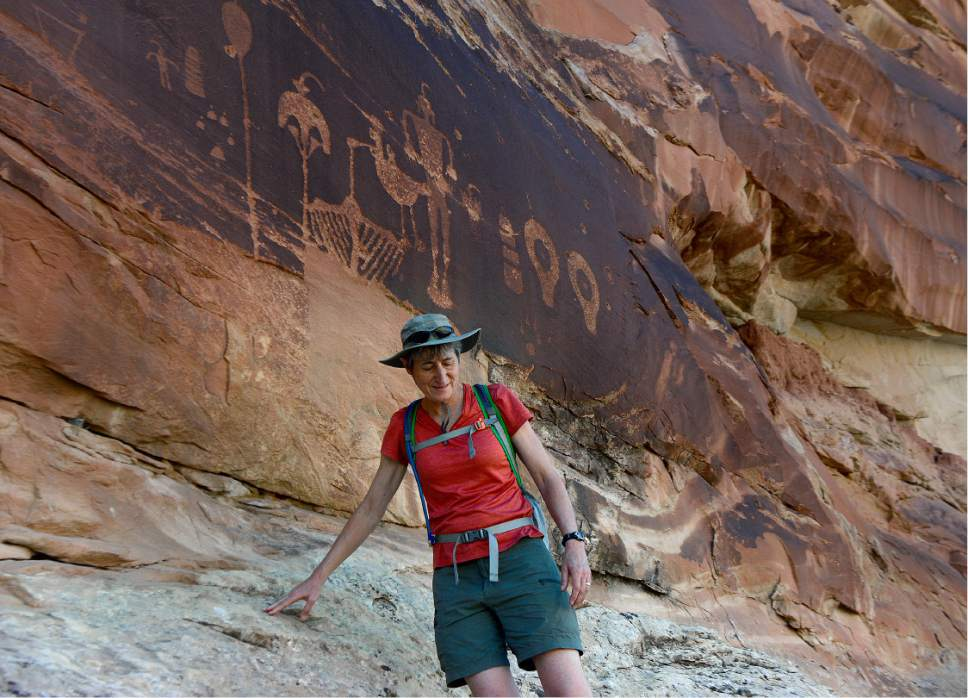 Scott Sommerdorf   |  The Salt Lake Tribune   U.S. Interior Secretary Sally Jewell scrambles down after getting a close look at ancient petroglyphs - some of which have been vandalized -  near Comb Ridge, Saturday, July 16, 2016.