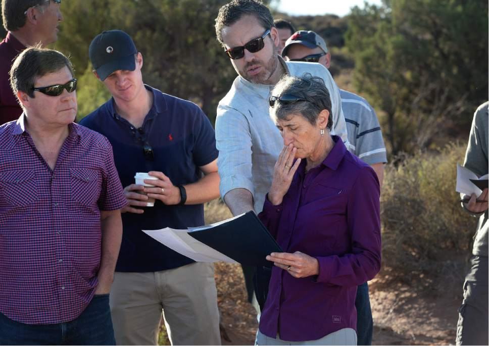 Scott Sommerdorf   |  The Salt Lake Tribune   Interior Secretary Sally Jewell looks at a map of the area near Gemini Bridges with SITLA attorney John Andrews, left, and BLM Director Neil Kornze, above, Thursday, July 14, 2016.