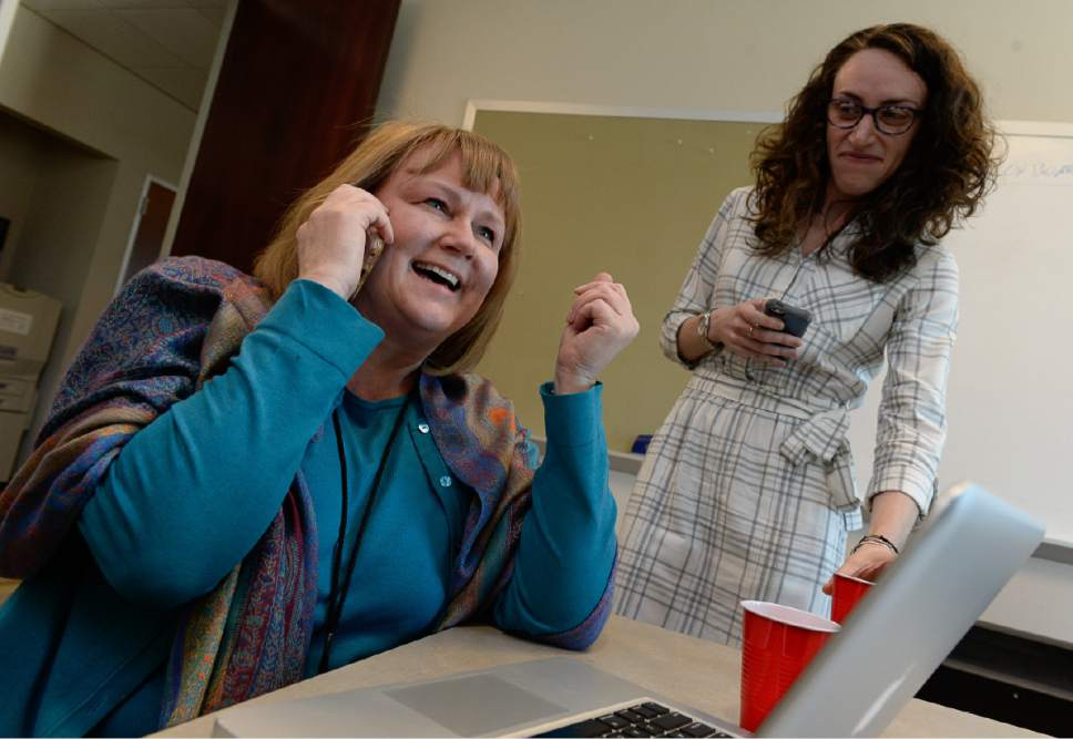 Francisco Kjolseth | The Salt Lake Tribune Managing Editor Sheila McCann fields calls and celebrates alongside reporter Alex Stuckey as The Salt Lake Tribune wins its second Pulitzer Prize in its nearly 150-year history Monday, earning the nod in local reporting for its groundbreaking investigation of rape at Utah colleges.