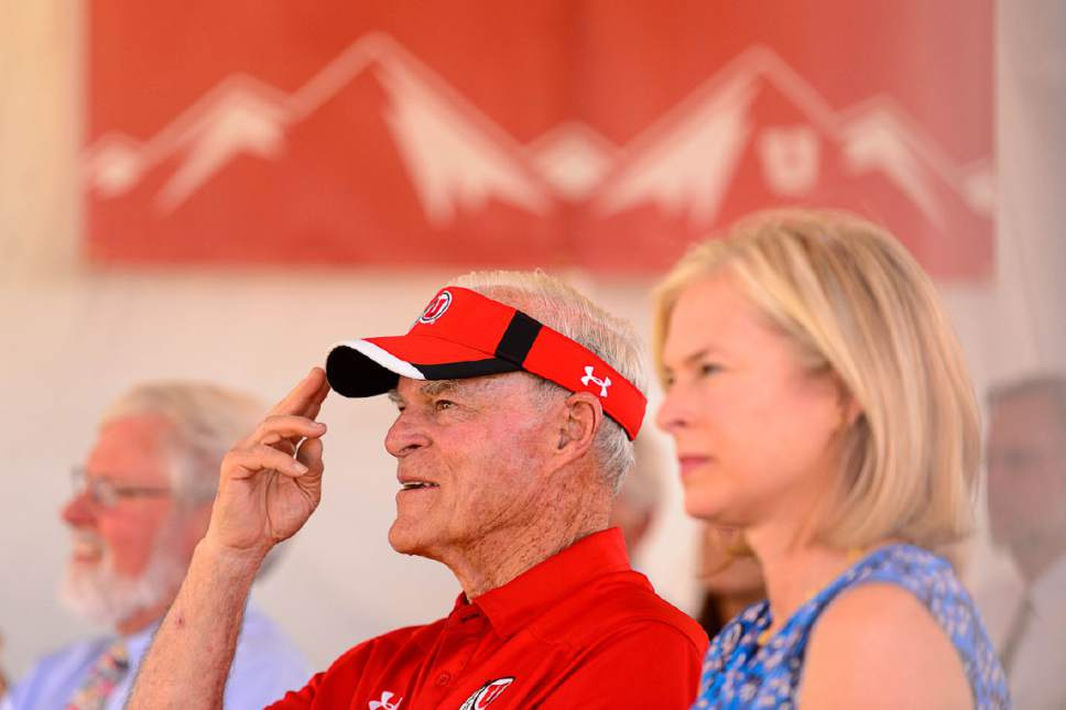 Trent Nelson  |  The Salt Lake Tribune Spence Eccles salutes University of Utah Director of Athletics Chris Hill at the groundbreaking for the school's new ski team building, Wednesday June 22, 2016. Eccles is the lead donor of the project, and was a ski team standout himself back in the 1960s. At left is University President David Pershing and right is Lisa Eccles.