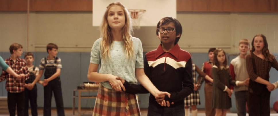 """Courtesy photo  Young Smith (Roni Akurati, right) winds up with his crush, Amy Brunner (Brighton Sharbino), as a dance partner, in a scene from the coming-of-age comedy """"Growing Up Smith."""""""