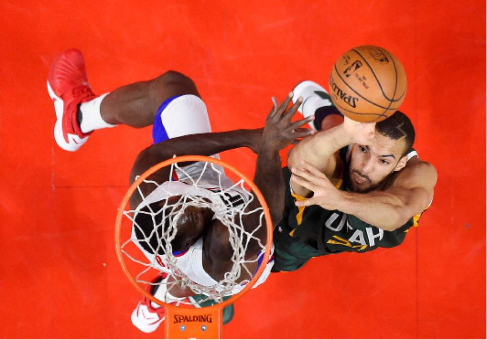 Utah Jazz center Rudy Gobert, right, shoots as Los Angeles Clippers guard Raymond Felton defends during the first half in Game 5 of an NBA basketball first-round playoff series, Tuesday, April 25, 2017, in Los Angeles. (AP Photo/Mark J. Terrill)