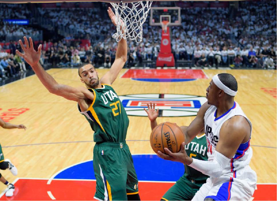 Los Angeles Clippers forward Paul Pierce, right, looks to pass as Utah Jazz center Rudy Gobert defends during the first half in Game 5 of an NBA basketball first-round playoff series, Tuesday, April 25, 2017, in Los Angeles. (AP Photo/Mark J. Terrill)