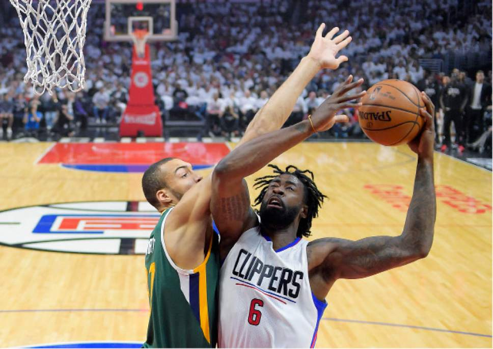 Los Angeles Clippers center DeAndre Jordan looks for a shot as Utah Jazz center Rudy Gobert defends during the first half in Game 5 of an NBA basketball first-round playoff series, Tuesday, April 25, 2017, in Los Angeles. (AP Photo/Mark J. Terrill)