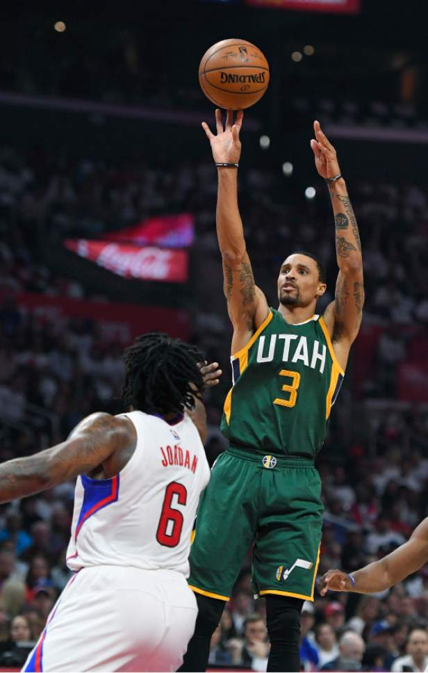 Utah Jazz guard George Hill shoots as Los Angeles Clippers center DeAndre Jordan defends during the first half in Game 5 of an NBA basketball first-round playoff series, Tuesday, April 25, 2017, in Los Angeles. (AP Photo/Mark J. Terrill)