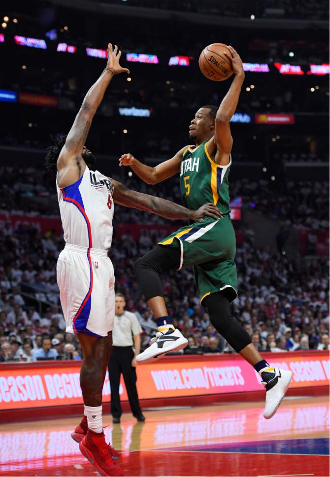 Utah Jazz guard Rodney Hood, right, shoots as Los Angeles Clippers center DeAndre Jordan defends during the first half in Game 5 of an NBA basketball first-round playoff series, Tuesday, April 25, 2017, in Los Angeles. (AP Photo/Mark J. Terrill)