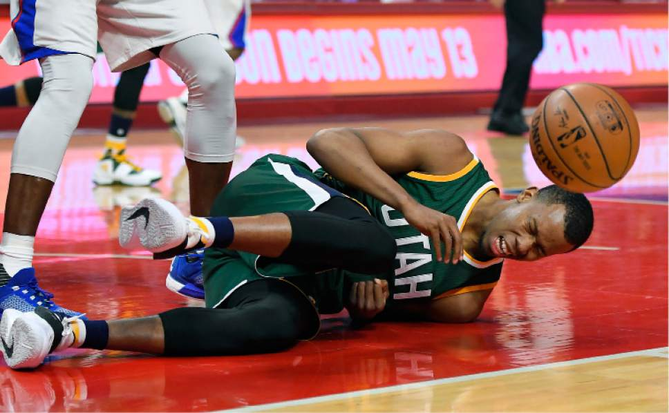 Utah Jazz guard Rodney Hood goes down hard after trying to shoot as Los Angeles Clippers center DeAndre Jordan defended during the first half in Game 5 of an NBA basketball first-round playoff series, Tuesday, April 25, 2017, in Los Angeles. (AP Photo/Mark J. Terrill)