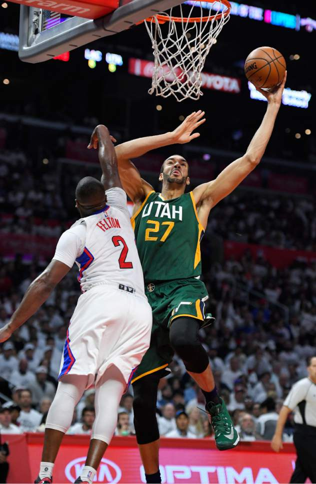Utah Jazz center Rudy Gobert shoots as Los Angeles Clippers guard Raymond Felton defends during the first half in Game 5 of an NBA basketball first-round playoff series, Tuesday, April 25, 2017, in Los Angeles. (AP Photo/Mark J. Terrill)