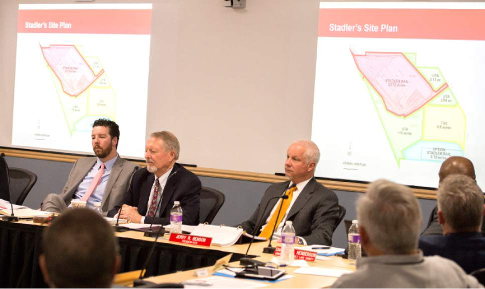 Leah Hogsten  |  The Salt Lake Tribune  l-r Jayme Blakesley, Robert McKinley and UTA President and CEO, Jerry Benson discuss the Clearfield The Utah Transit Authority Board discussed  logistics of the controversial UTA Clearfield land deal during their open meeting, Wednesday, April 26, 2017.