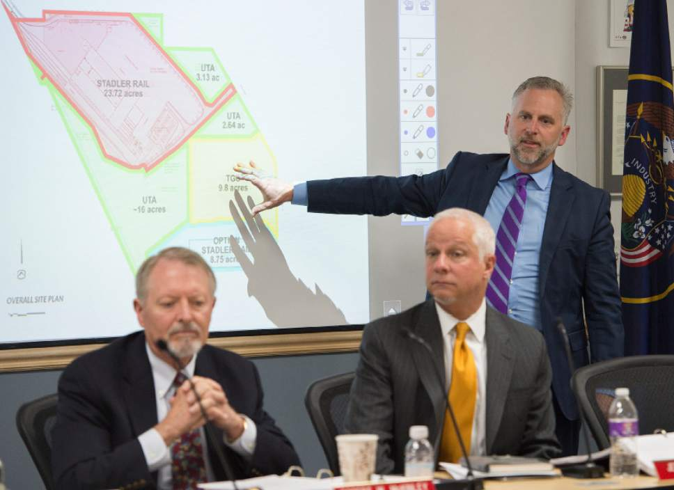 Leah Hogsten  |  The Salt Lake Tribune  l-r UTA board chair Robert McKinley,  President and CEO Jerry Benson and Bret Millburn discuss the Clearfield land site. The Utah Transit Authority Board discussed  logistics of the controversial UTA Clearfield land deal during their open meeting, Wednesday, April 26, 2017.