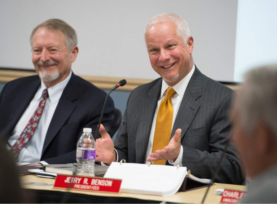 Leah Hogsten     The Salt Lake Tribune  l-r Robert McKinley and UTA President and CEO, Jerry Benson discuss the Clearfield land site.  The Utah Transit Authority Board discussed  logistics of the controversial UTA Clearfield land deal during their open meeting, Wednesday, April 26, 2017.