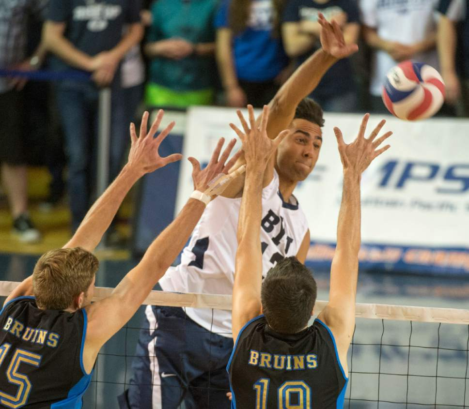 Rick Egan  |  The Salt Lake Tribune  Brigham Young Cougars Ben Patch (13) hits the ball past UCLA Bruins Jake Arnitz (15) and UCLA Bruins Eric Sprague (19), in the Mountain Pacific Sports Federation Volleyball Championship game, in tournament action at the Smith Field House in Provo, Saturday, April 23, 2016.