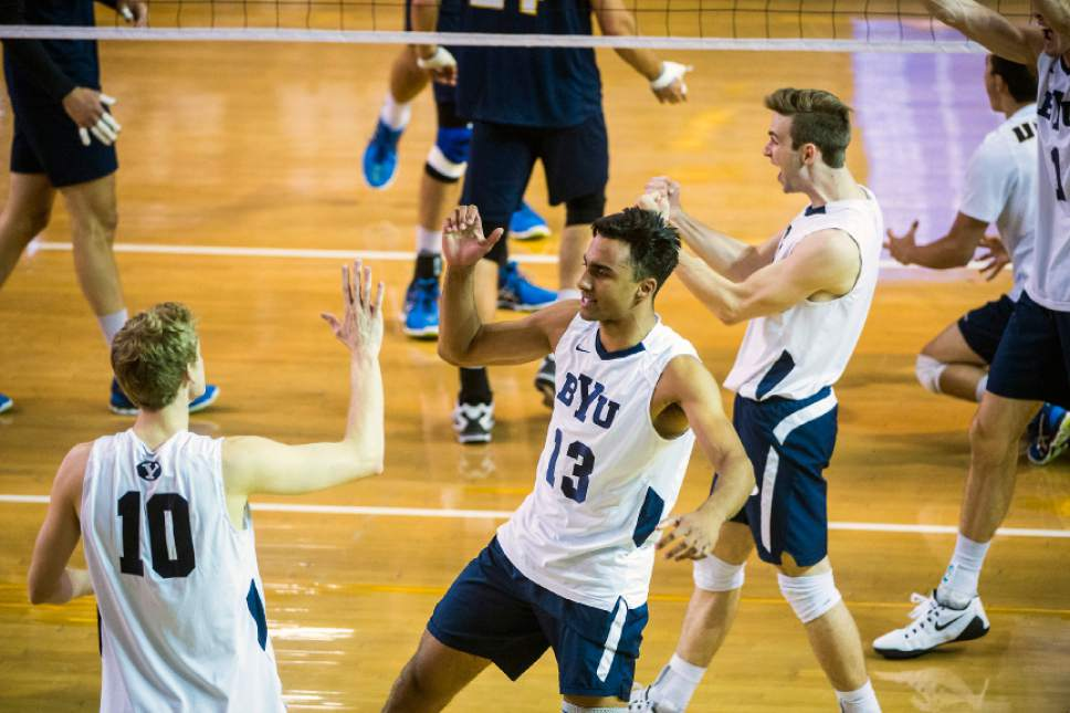 Chris Detrick     The Salt Lake Tribune BYU's Jake Langlois (10) and Ben Patch (13) celebrate a point during the MPSF tournament semifinal at Smith Fieldhouse Thursday April 21, 2016.