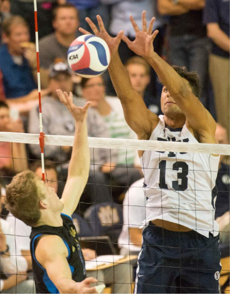 Rick Egan  |  The Salt Lake Tribune  Brigham Young Cougars Ben Patch (13) blocks a hit, in the Mountain Pacific Sports Federation Volleyball Championship, in tournament action at the Smith Field House in Provo, Saturday, April 23, 2016.
