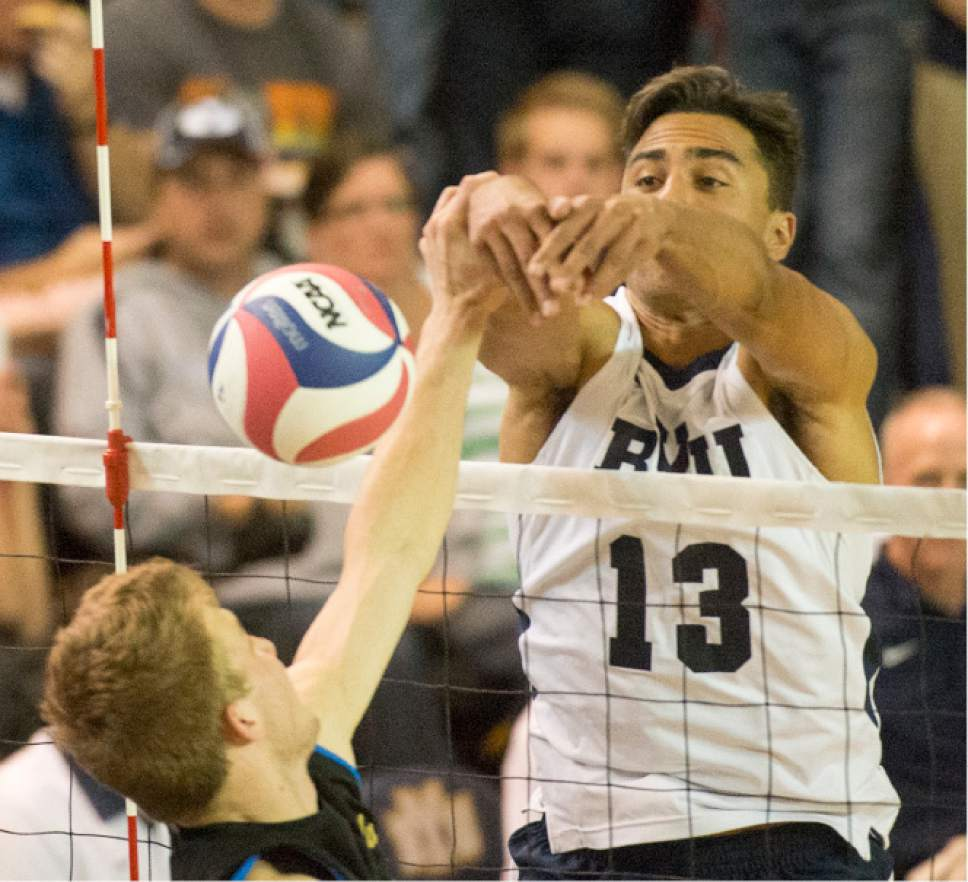 Rick Egan     The Salt Lake Tribune  Brigham Young Cougars Ben Patch (13) blocks a hit, in the Mountain Pacific Sports Federation Volleyball Championship, in tournament action at the Smith Field House in Provo, Saturday, April 23, 2016.