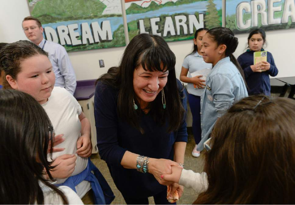 """Francisco Kjolseth   The Salt Lake Tribune Writer Sandra Cisneros gets a warm reception as she visits Mountain View Elementary School on Wed. April 26, 2017, where she spoke with 40 fifth graders who have have read her book, """"The House on Mango Street,"""" in both english and spanish as part of their dual immersion program."""