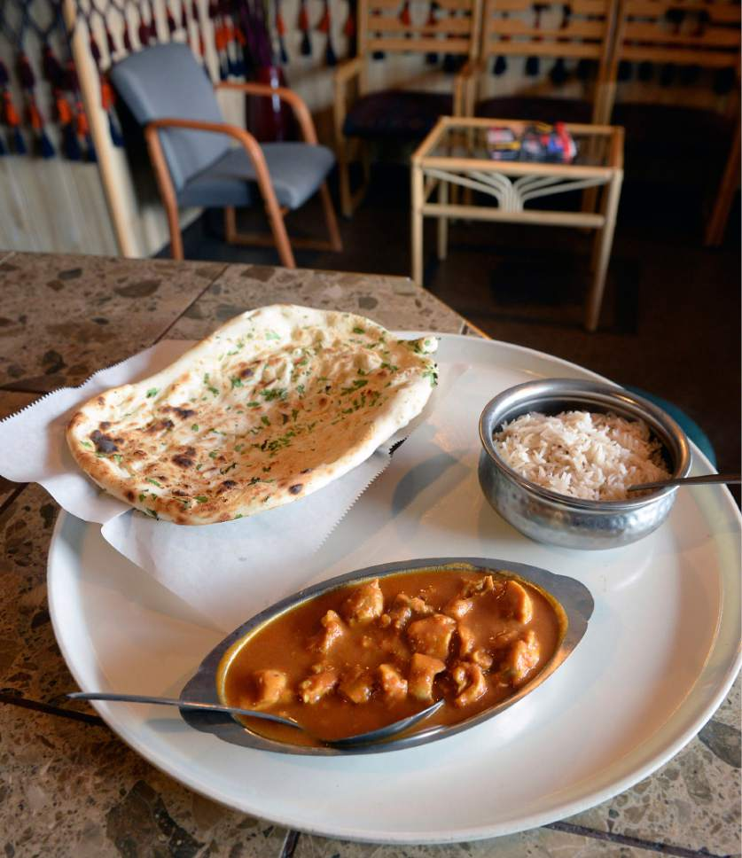 Authentic afghanistan cuisine finds a home on main street south al hartmann the salt lake tribune curry chicken with rice and garlic naan at afghan forumfinder Choice Image