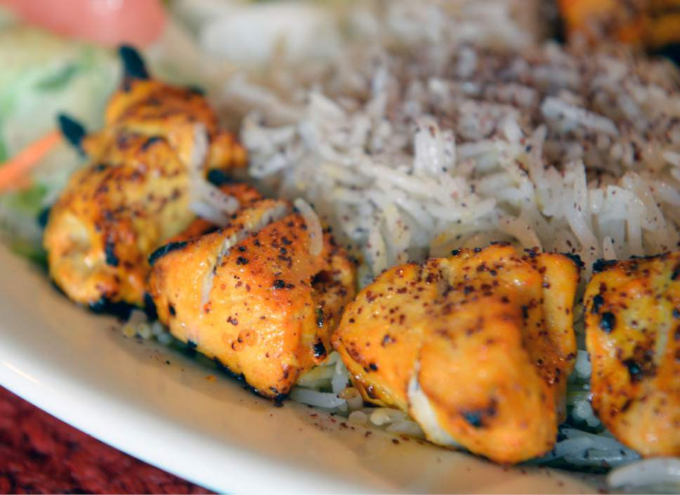 Al Hartmann  |  The Salt Lake Tribune Chicken Tikka Kabab, marinated boneless chicken breast barbequed over grill and served with rice and salad at Afghan Kitchen, a new restaurant in South Salt Lake.
