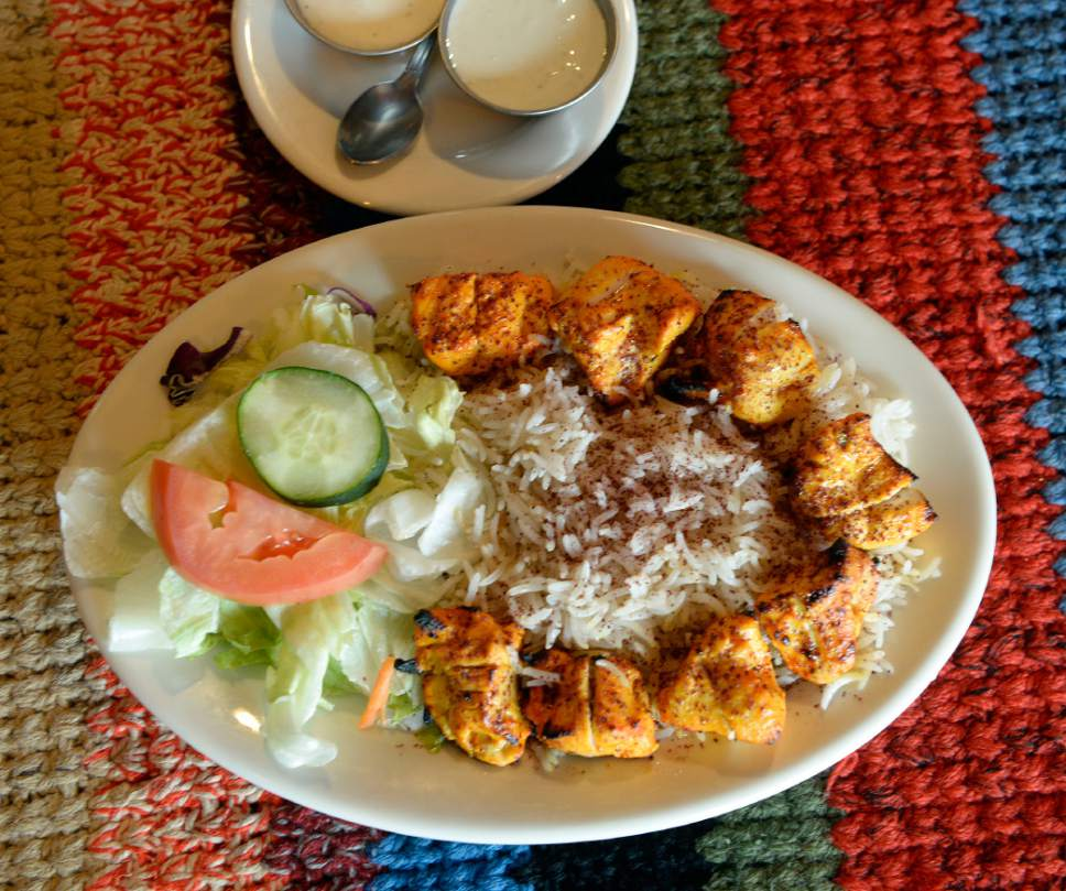 Al Hartmann  |  The Salt Lake Tribune Dish of the week. Chicken Tikka Kabab, marinated boneless chicken breast barbequed over grill and served with rice and salad at Afghan Kitchen, a new restaurant in South Salt Lake.
