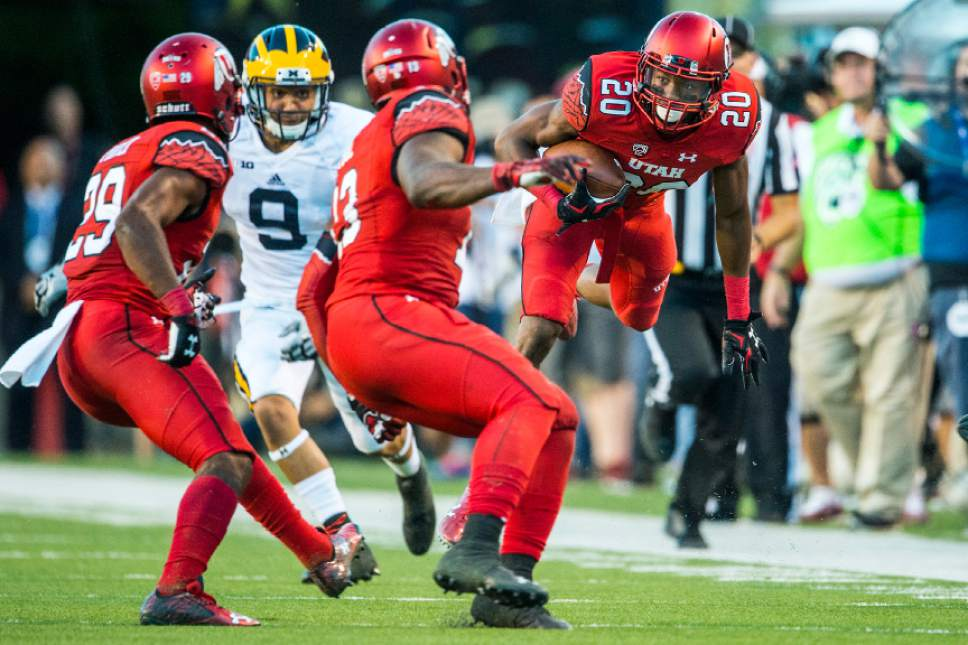 Chris Detrick  |  The Salt Lake Tribune Utah Utes defensive back Marcus Williams (20) intercepts the ball past Michigan Wolverines wide receiver Grant Perry (9) during the first half of the game at Rice-Eccles Stadium Thursday September 3, 2015.  Utah is winning 10-3 at halftime.