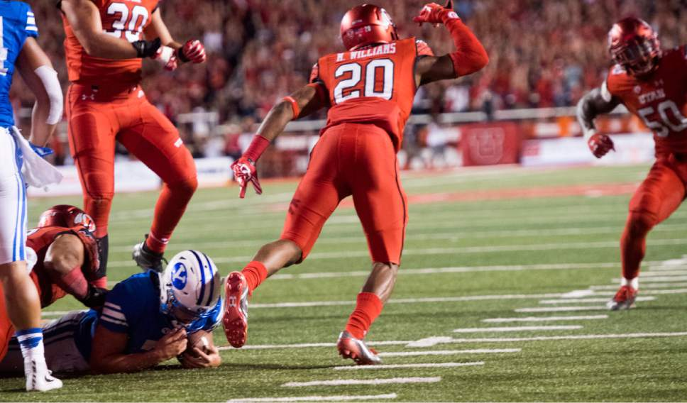 Rick Egan  |  The Salt Lake Tribune  Utah Utes defensive back Marcus Williams (20) celebrates after stopping Brigham Young Cougars quarterback Taysom Hill (7) from scoring the 2-point conversion, resulting in a Utah 20-19 win over BYU, in football action, at Rice-Eccles Stadium, Saturday, September 10, 2016.