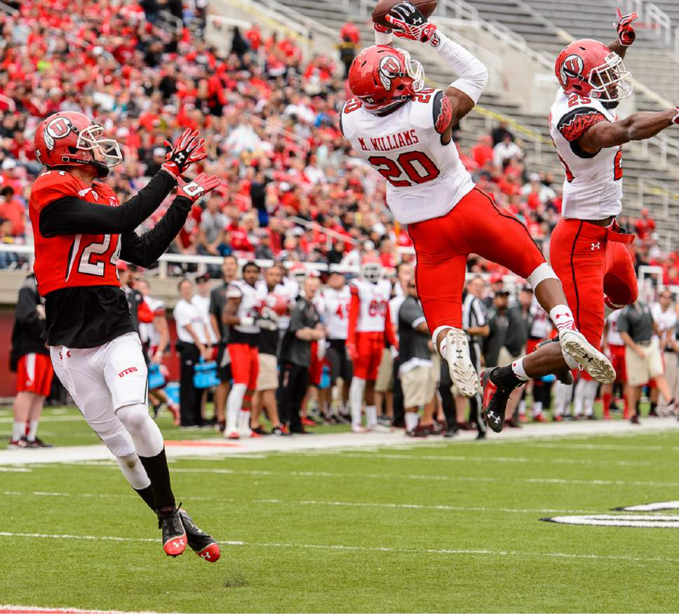 Trent Nelson  |  The Salt Lake Tribune Marcus Williams (20) pulls in game ending touchdown interception at the Utah Football Red & White game in Salt Lake City, Saturday April 25, 2015.
