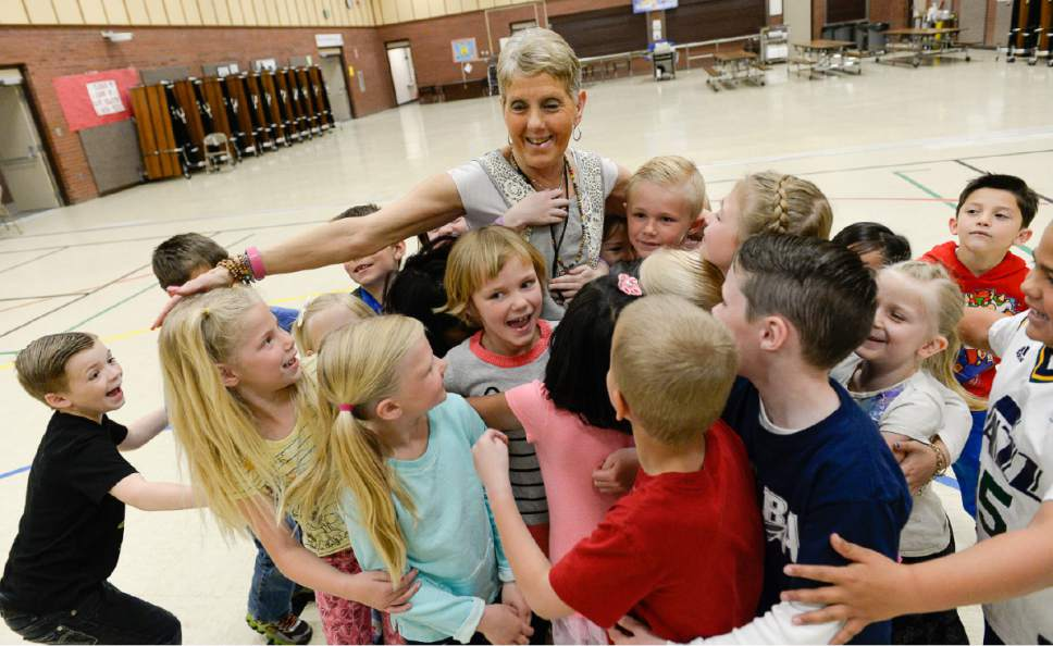 Francisco Kjolseth | The Salt Lake Tribune Joani Richardson, First grade teacher at Altara Elementary School in Sandy is embraced by her students after being announced as  the final winner of the 2017 Huntsman Awards for Excellence in Education on Friday, April 28, 2017.