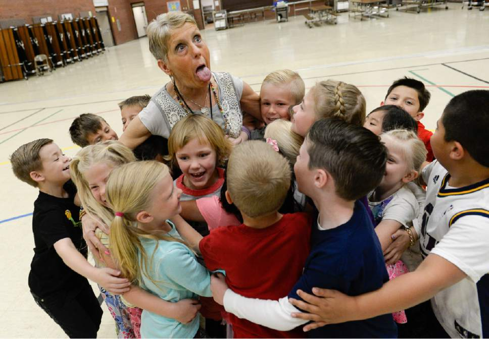 Francisco Kjolseth  |  The Salt Lake Tribune Joani Richardson, First grade teacher at Altara Elementary School in Sandy gets a group hug from her students after being announced as  the final winner of the 2017 Huntsman Awards for Excellence in Education on Friday.