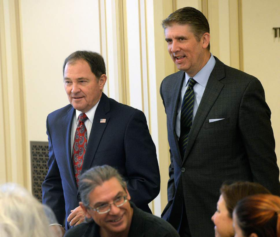 Al Hartmann  |   Tribune file photo Utah Valley University President Matthew Holland, right, with Gov. Gary Herbert in January, emerged at the top of a survey gauging strength of potential 3rd Congressional District candidates to replace Rep. Jason Chaffetz.