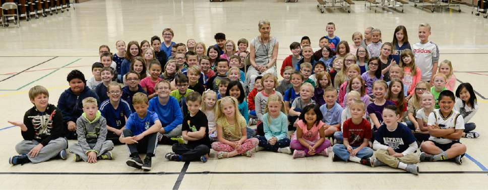 Francisco Kjolseth | The Salt Lake Tribune Joani Richardson, First grade teacher at Altara Elementary School in Sandy poses for a photograph with current and former students after being announced as  the final winner of the 2017 Huntsman Awards for Excellence in Education on Friday, April 28, 2017.