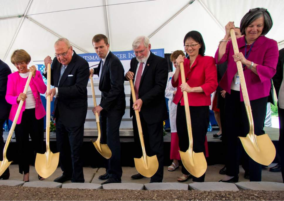 File photo | Trent Nelson  |  The Salt Lake Tribune Members of the Huntsman family joined University of Utah President David Pershing, Health Sciences Senior Vice President Vivian Lee and Huntsman Cancer Institute Director Mary Beckerle in June 2014 to break ground on the institute's new wing, the Primary Children's and Families Cancer Research Center, now slated to open in June. Earlier this month, the Huntsmans clashed with Pershing and Lee after Lee fired Beckerle, who Pershing has since reinstated. Left to right, Karen Huntsman, Jon Huntsman Sr., David Huntsman, Pershing, Lee and Beckerle.